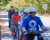 People bicycling